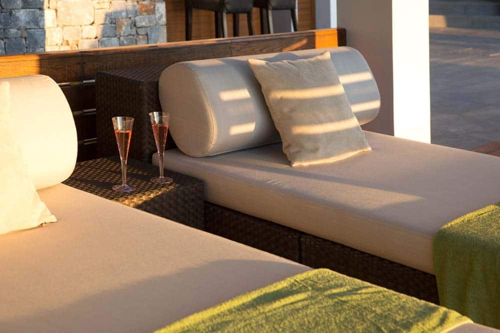 Shaded sunbeds by the pool at Villa Terra Creta