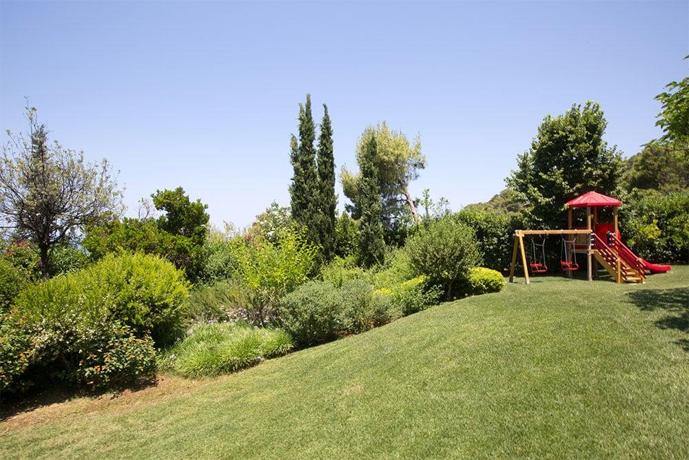 A view to the garden and the playground of Villa Terra Creta