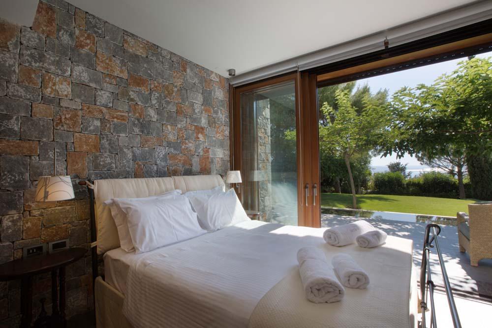 Double bedroom with garden and sea views on the lower ground floor