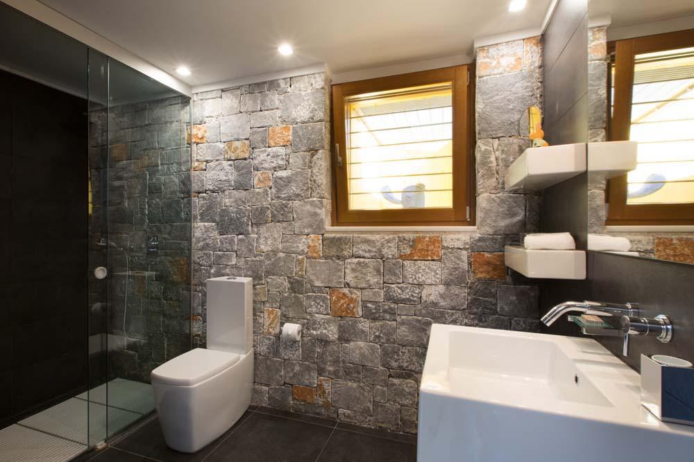 En-suite bathroom built in natural stone
