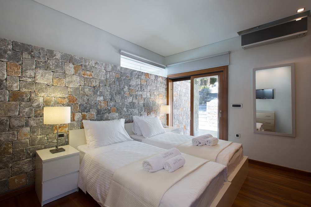 Twin bedroom with private balcony on the upper floor