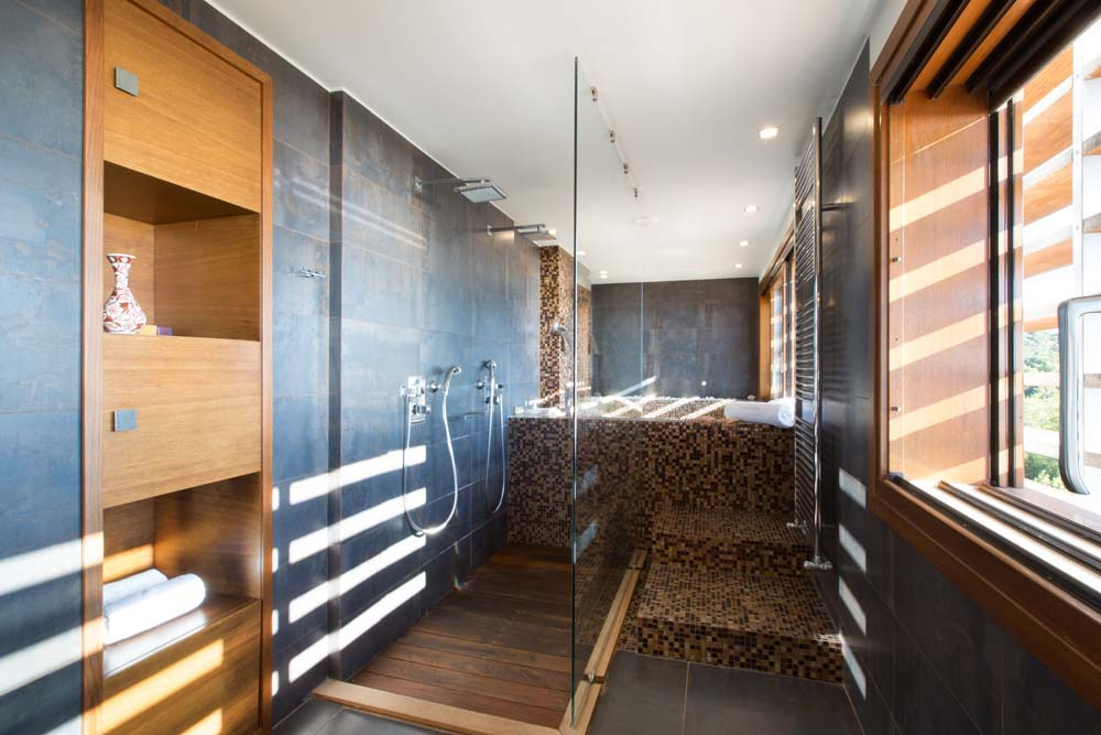 Double shower and private plunge heated pool in master bedroom at Villa Terra Creta